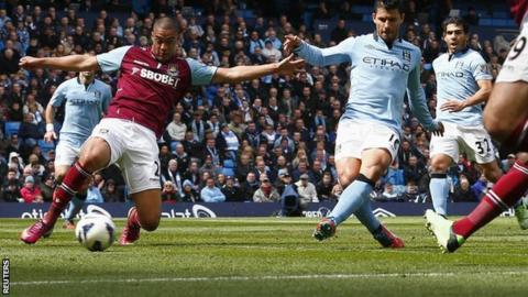 Man City striker Sergio Aguero (second from right) slots in a goal against West Ham