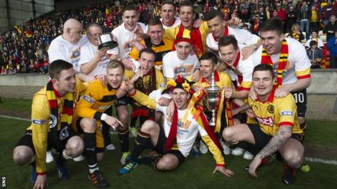 Partick Thistle celebrate after receiving the Division One trophy