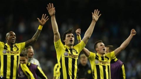Dortmund's players celebrate at the final whistle