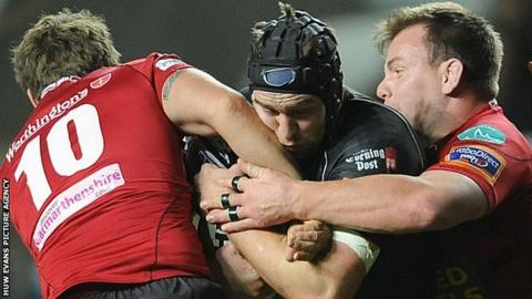 Ospreys back row Ryan Jones takes on the Scarlets defence