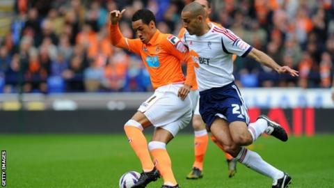 Blackpool's Tom Ince battles for possession