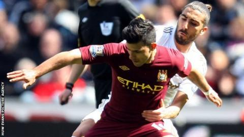 Manchester City's Sergio Aguero clashes with Swansea defender Chico Flores during the Premier League clash at the Liberty Stadium.