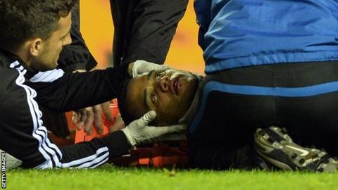 Michel Vorm is treated on the field at Wigan