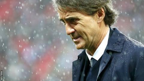 Roberto Mancini in the rain