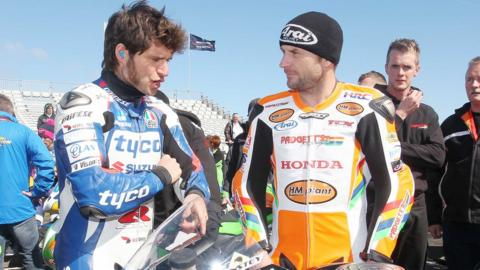 Guy Martin and New Zealand rider Bruce Anstey have a chat in the paddock as the sun shines on the north coast