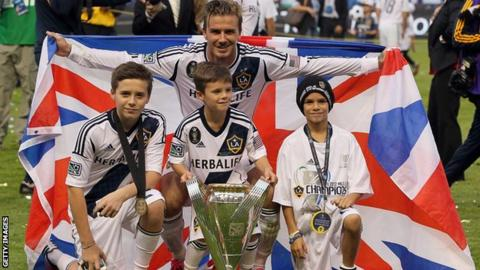 David Beckham poses with his sons Brooklyn Beckham, Cruz Beckham and Romeo Beckham