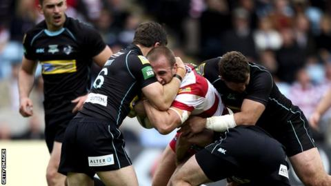 London Broncos tackle Wigan's Lee Mossop