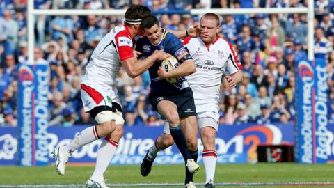 Ulster's Robbie Diack and Tom Court attempt to halt the progress of Leinster fly-half Jonathan Sexton