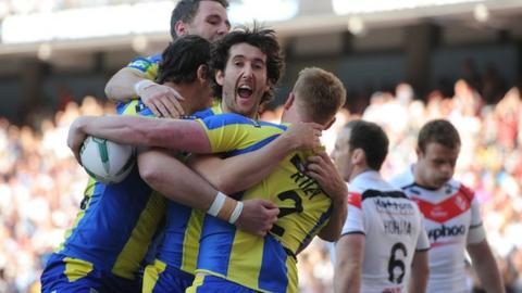 Warrington celebrate Chris Riley's opening try
