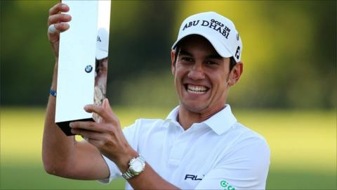 Matteo Manassero of Italy celebrates with the trophy