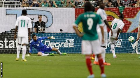 Nigeria's Brown Ideye scoring from the penalty spot against Mexico