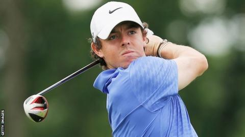 Rory McIlroy drives at the first hole in the third round