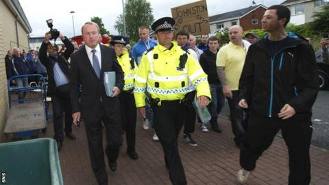 Fans protest to Kilmarnock chairman Michael Johnston
