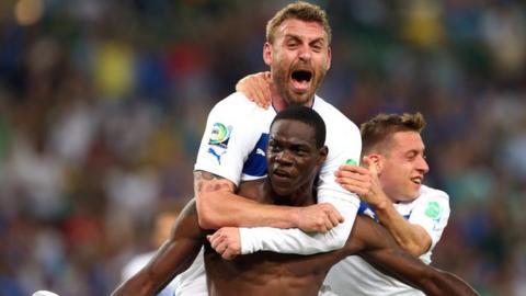 Mario Balotelli scores for Italy