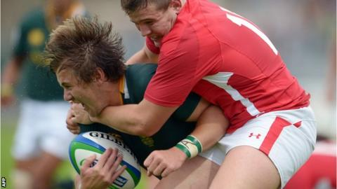 South Africa's Stefan Ungerer is tackled by Wales wing Hallam Amos
