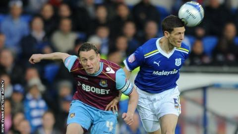 Kevin Nolan of West Ham and Mark Hudson of Cardiff City compete during the 2012 Championship Play-Off semi-final first leg