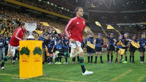 Sam Warburton leads the Lions out