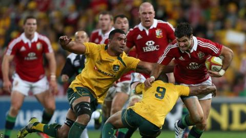 Mike Phillips is tackled by Will Genia