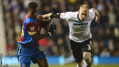 Gareth Roberts tackles Wilfried Zaha