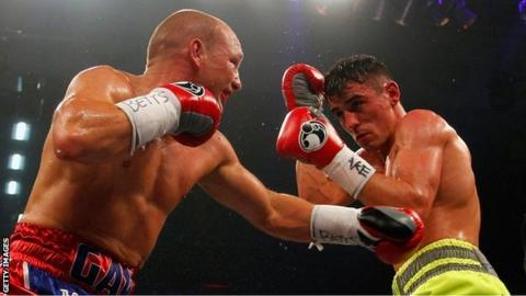 Gavin Rees (left) exchanges blows with Anthony Crolla
