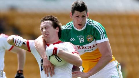 Tyrone's Colm Cavanagh is fouled by Offaly's Padraig Bracken