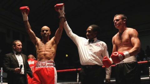 Leon McKenzie (left) is awarded the win over John Mason