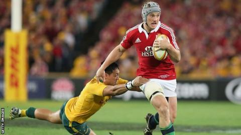 Jonathan Davies beats an Australian defender during the Lions' 41-16 win over the Wallabies in Sydney