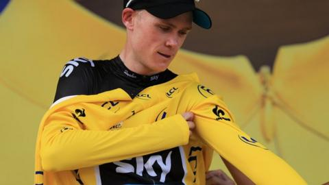 Froome climbs into yellow jersey