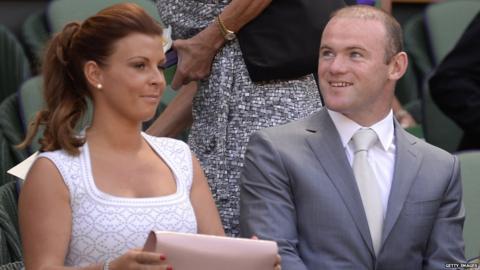 Colleen and Wayne Rooney await the start of the 2013 Wimbledon final
