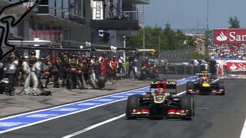 Mark Webber's wheel flies off in the pitlane