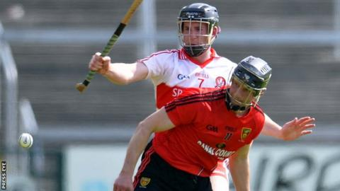 Paul Braniff battles with Malachy O'Hagan in the Ulster hurling semi-final replay