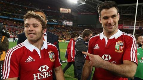 Leigh Halfpenny and Mike Phillips celebrate the 2013 Lions win