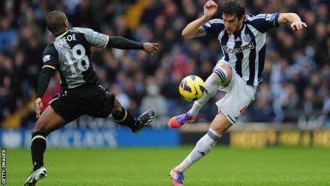 Goran Popov (right) in action against Tottenham Hotspur