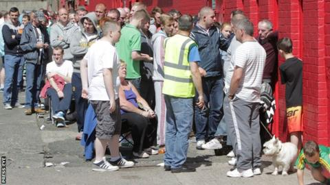 Fans queue for tickets outside Cliftonville's ground in north Belfast