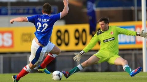 Jamie Mulgrew fires past IF Fuglafjordur keeper Jakup Mikkelsen to score Linfield's second goal in the 3-0 win and 5-0 aggregate victory