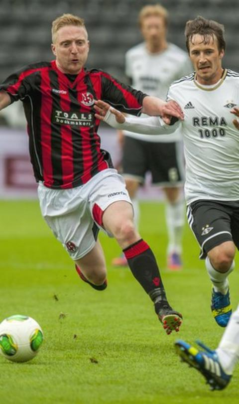 Crusaders midfielder Chris Morrow battles for possession with Rosenborg's Mike Jensen in Trondheim