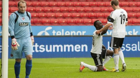 John Chibuke celebrates after scoring past Crusaders keeper Sean O'Neill in Rosenborg's 7-2 victory and 9-2 aggregate win