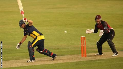 Jim Allenby plays an unorthodox one-handed shot during Glamorgan's win over Somerset