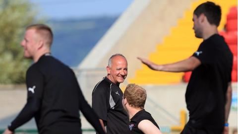 Tommy Breslin chats to Liam Boyce during Cliftonville training on Monday