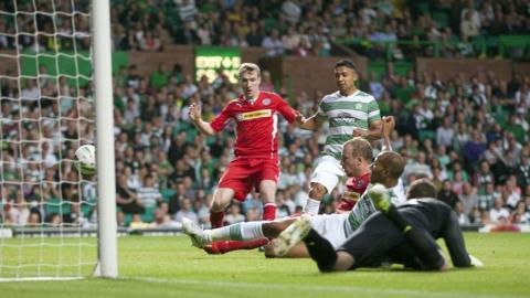 Cliftonville go close in the second half as the ball flashes across the Celtic goal