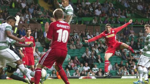 Cliftonville substitute Joe Gormley sees his powerful shot blocked close to the Celtic line