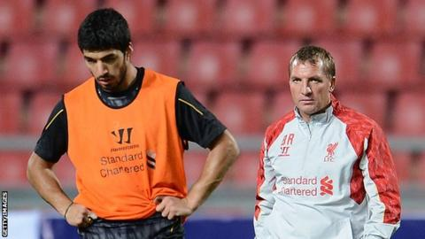 Luis Suarez (l) and Brendan Rodgers
