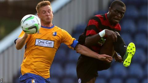 Gabby Zakuani (right) battles with Mansfield's Lee Stevenson