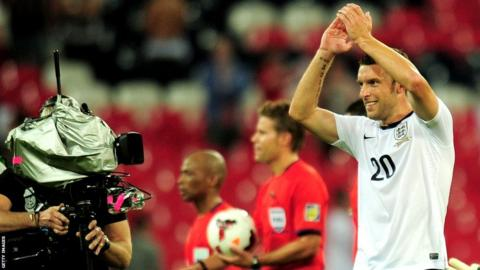 Rickie Lambert celebrates England's 3-2 win over Scotland