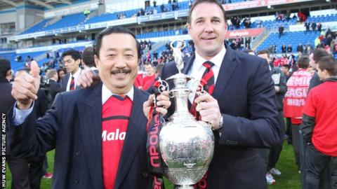Malky Mackay and Vincent Tan with the Championship trophy