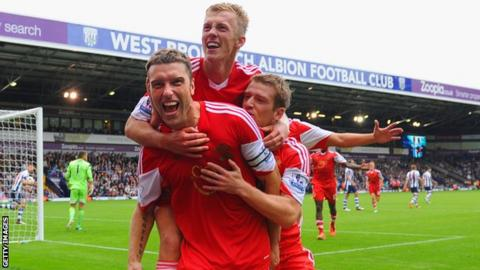 Southampton striker Rickie Lambert celebrates after scoring the winner against West Bromwich Albion