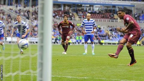Troy Deeney scores a penalty for Watford at Reading