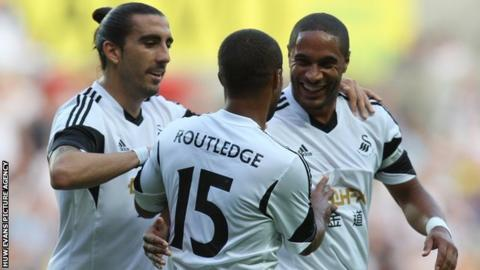 Wayne Routledge gets the Swansea congratulations