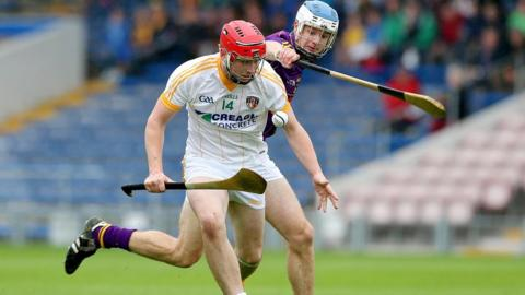 Conor McCann of Antrim is challenged by Wexford's Shane O'Gorman during the Under-21 semi-final at Semple Stadium