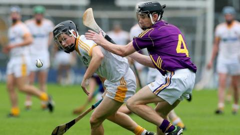 Daniel McKiernan of Antrim comes under pressure from Wexford opponent Eoin Conroy during the semi-final at Thurles